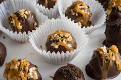 Homemade healthy chocolate truffles. Homemade healthy cheesecake chocolate truffles on a dish royalty free stock photo