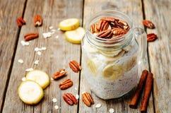 Homemade healthy Chia seeds banana pecan overnight oatmeal in ja. Rs. toning. selective Focus Stock Photos