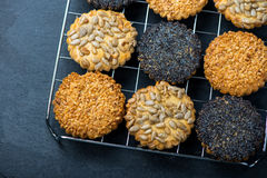 Homemade healthy cookie with seeds on cooling tray Royalty Free Stock Photos
