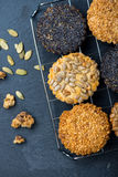 Homemade healthy cookie with seeds on cooling tray Royalty Free Stock Images
