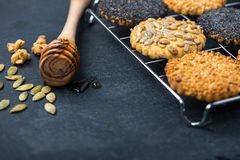 Homemade healthy cookie with seeds and honey on cooling tray Stock Photos