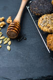 Homemade healthy cookie with seeds and honey on cooling tray Stock Images