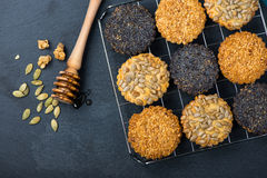 Homemade healthy cookie with seeds and honey on cooling tray Royalty Free Stock Photo