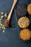 Homemade healthy cookie with seeds and honey on cooling tray Royalty Free Stock Photography