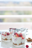 Homemade healthy dessert in glass with yogurt, fresh fruits and cookies for breakfast. Homemade healthy dessert with yogurt, fresh fruits and cookies for Royalty Free Stock Photography