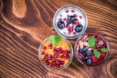 Homemade healthy desserts with fresh fruits in jars royalty free stock photo