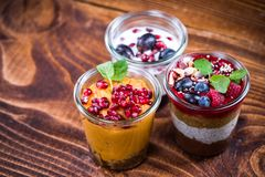 Homemade healthy desserts with fresh fruits in jars stock photos