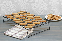 Free Homemade Healthy Dog Bones Cooling On A Metal Rack. Selective F Stock Photo - 58680360