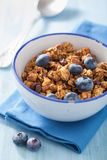 Homemade healthy granola with blueberry for breakfast Stock Photos