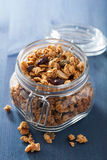 Homemade healthy granola in glass jar Stock Images