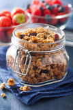 Homemade healthy granola in glass jar and berries Stock Photo