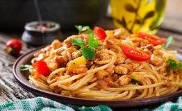 Spaghetti bolognese pasta with tomato sauce, vegetables and minced meat. Homemade healthy italian pasta on rustic wooden background stock photos