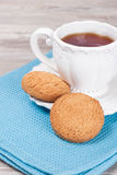 Homemade healthy oatmeal cookies with a cup of tea Stock Images