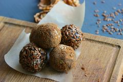 Homemade healthy raw vegan sweet balls with nuts,raisins, dates, cocoa and flax seeds. Healthy vegan food concept royalty free stock images