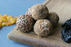 Homemade healthy raw vegan sweet balls with nuts,raisins, dates, cocoa and flax seeds. Healthy vegan food concept royalty free stock photography