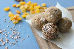 Homemade healthy raw vegan sweet balls with nuts,raisins, dates, cocoa and flax seeds. Healthy vegan food concept royalty free stock photos