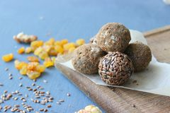 Homemade healthy raw vegan sweet balls with nuts,raisins, dates, cocoa and flax seeds. Healthy vegan food concept stock photos
