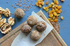 Homemade healthy raw vegan sweet balls with nuts,raisins, dates, cocoa and flax seeds. Healthy vegan food concept royalty free stock photo