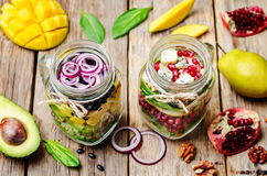 Homemade healthy salads with vegetables, fruits, beans and quinoa Royalty Free Stock Photo