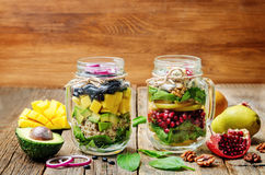 Homemade healthy salads with vegetables, fruits, beans and quinoa Royalty Free Stock Image