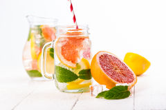 Homemade healthy smoothie with fresh fruits and ice in jar. Stock Images