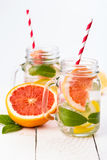 Homemade healthy smoothie with fresh fruits and ice in jar. Stock Photography