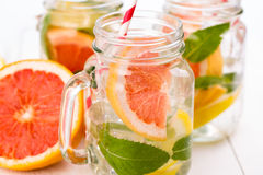 Homemade healthy smoothie with fresh fruits and ice in jar. Stock Photos