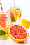 Homemade healthy smoothie with fresh fruits and ice in jar. Stock Photo