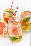 Homemade healthy smoothie with fresh fruits and ice in jars. Stock Photography