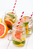 Homemade healthy smoothie with fresh fruits and ice in jars. Stock Photos