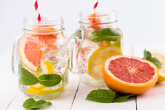 Homemade healthy smoothie with grapefruit and lemon in jar. Royalty Free Stock Photo