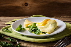 Homemade healthy spinach omelette on rural table Stock Photo