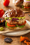 Homemade Healthy Turkey Burgers. With Lettuce and Tomato Stock Photo