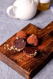 Homemade healthy vegan chocolate candy. Close up, top view, vertical Royalty Free Stock Photos