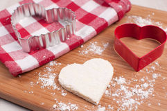 Homemade heart cookie with cutter Royalty Free Stock Photo