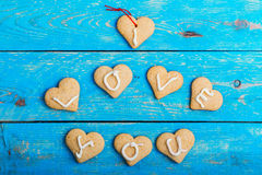 Homemade heart shape cookies on blue background, words I LOVE YO Royalty Free Stock Photography