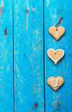 Homemade heart shape cookies on blue background, words I LOVE YO Royalty Free Stock Image