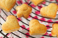Homemade heart shaped banana muffins cooling on metal rack Stock Photos