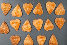 Homemade heart shaped cookies with a sugar crust on metal baking Stock Image
