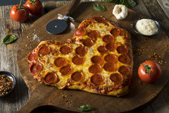 Homemade Heart Shaped Pepperoni Pizza. Ready to Eat royalty free stock photo