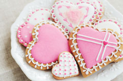 Homemade heart shaped sugar cookies with icing on white plate Stock Photos