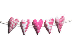 Homemade hearts hanging on clothes line Stock Photo