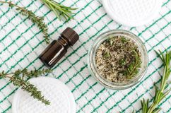 Homemade herbal scrub foot soak or bath salt with rosemary, thyme, sea salt, olive oil and essential oils. Natural skin and hair care. DIY beauty treatments stock photo