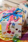 Homemade holiday packaging with bows and stars stock images