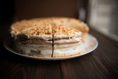Homemade honey cake with cut piece on a table Royalty Free Stock Photos