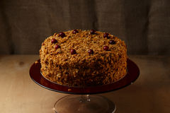 Homemade honey cake with nuts and spices. Royalty Free Stock Photography