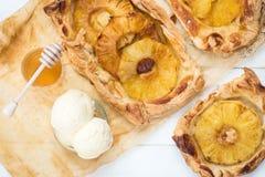 Homemade honey-glazed pineapple tarts Stock Images