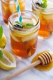 Homemade honey iced tea. In mason jars with straws Royalty Free Stock Photos