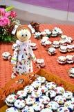 Homemade honey jars with doll stock image