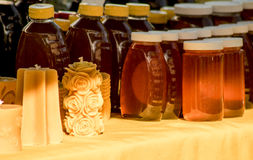Homemade honey in jars. And wax candles from honey bees Stock Photo